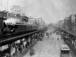 Elevated trains roll above busy streets in Manhattan's Bowery neighborhood, circa 1895.