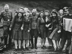 The photos were taken between May and December 1944, and they show the officers and guards of the Auschwitz relaxing and enjoying themselves — as countless people were being murdered and cremated at the nearby death camp. In some of the photos, SS officers can be seen singing. In others they are hunting and in another a man can be seen decorating a Christmas tree in what could only be described as a holiday in hell.